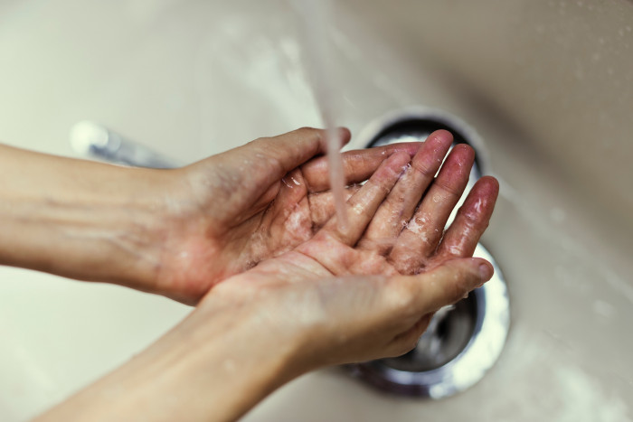Washing hands in a sterile setting
