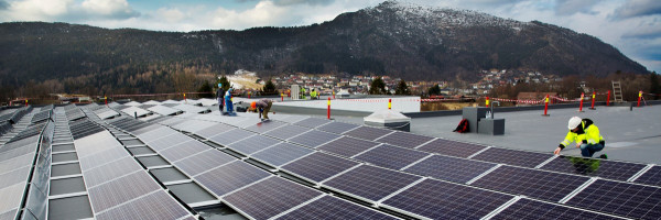 Solar cell and workers in front of mountains